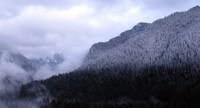 Carbon River hills snowy dusk