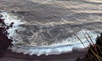 a wave touches Tillamook Head