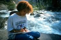 Summer writing at top of falls in Yosemite