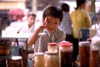 Vietnamese market girl imitating photographer 1970