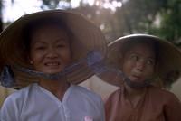 Vietnamese women sort of tolorating the photographer 1970