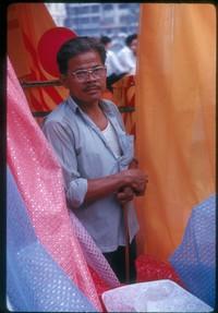 ss 016 1970 02 01 saigon market colorful cloth